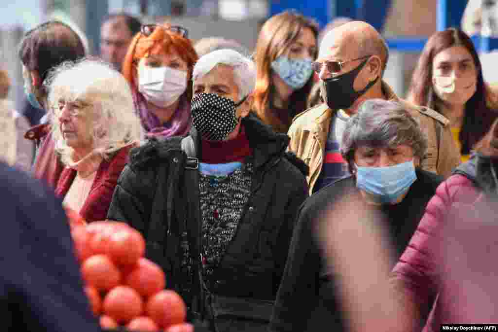 People wear face masks as they shop in Sofia's largest outdoor food market. (AFP/Nikolay Doychinov)
