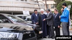 Iran -- Iranian President Hassan Rouhani visiting a car factory on February 19, 2020.