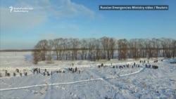 Russian Crews Comb Through Snowy Crash Site