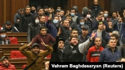 Protesters storm the parliamentary assembly in Yerevan on November 10 after Armenian Prime Minister Nikol Pashinian said he had signed an agreement with the leaders of Russia and Azerbaijan to end the war in Nagorno-Karabakh.