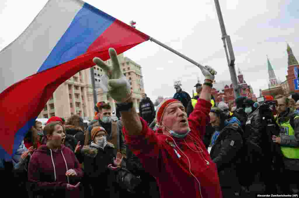 A demonstrator waves a Russian flag during a rally in Moscow in support of jailed opposition leader Aleksei Navalny in Moscow on April 21.