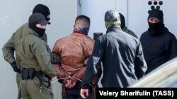 Stsyapan Latipav is arrested by Belarusian police in Minsk on September 15.