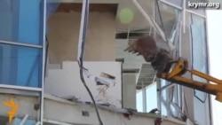 Aqmescitte daa bir binanı yıqalar