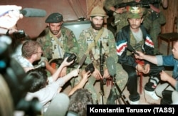 Shamil Basayev (center) gives a press conference on June 15, 1995, after he and his fighters took over 1,500 hostages in Budyonnovsk.