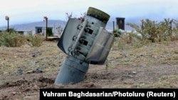 An unexploded rocket is seen near a graveyard in a town in Nagorno-Karabakh on October 1.