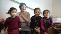 Қытайда қалған балаларымен табысқан отбасы