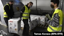 Boxes containing the Pfizer-BioNTech vaccine are unloaded at Budapest Liszt Ferenc International Airport on December 30.
