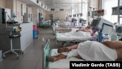 Patients lie in bed at a Moscow Hospital treating people suffering from COVID-19 on June 23.