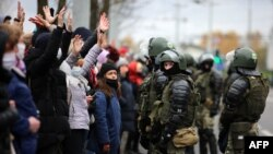 Riot police block protesters during a march of opposition supporters from central Minsk to a site of Stalin-era executions just outside the capital on November 1.
