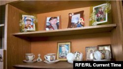 Photos displayed in Denis Mikhailenko's home, showing the teenager as a young boy.