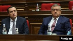 Davit Khachaturian (left) and Gagik Jahangirian attend a session of the Armenian parliament on January 22.