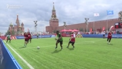 Refugees Play Football On Red Square