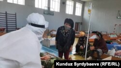 Doctors in Issyk-Kul, Kyrgyzstan, treat suspected patients with COVID-19 on July 16.