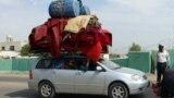 Afgani fugind din calea talibanilor în Helmand