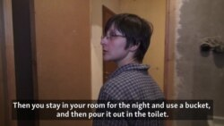 Russians Try To Make Ends Meet In Bleak Communal Apartment