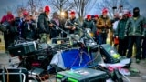 U.S. - Supporters of US President Donald Trump stand next to media equipment they destroyed during a protest on JAnuary 6, 2020 outside the Capitol in Washington, DC.