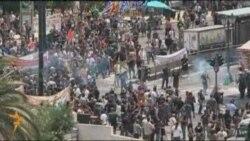 Афинда демонстрантлар белән полиция арасында бәрелешләр
