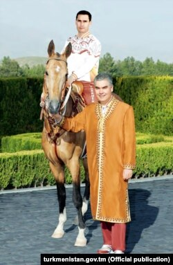 The Turkmen president with his son in a picture published in a Turkmen daily newspaper on June 7.
