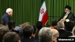 Iranian foreign minister Mohammad Javadi Zarif (L) in a meeting with Supreme Leader Ali Khamenei on August 13, 2014.