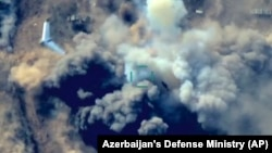 In this still taken from video released by Azerbaijan's Defense Ministry on October 1, an unmanned aerial vehicle flies over a site where Azerbaijan's forces are allegedly attacking Armenian military positions.