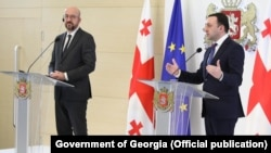 """European Council President Charles Michel (left) last week called on Prime Minister Irakli Gharibashvili (right) and the country's political parties to engage in dialogue to defuse the """"worsening crisis."""""""