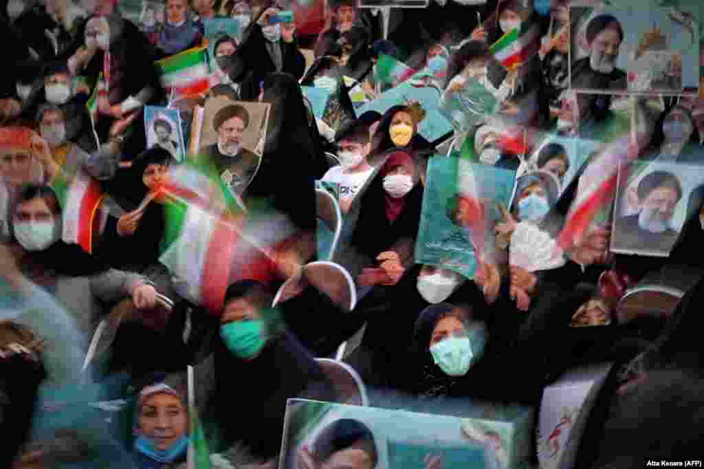Supporters of hard-line Iranian presidential candidate Ebrahim Raisi attend a campaign rally in the capital, Tehran.