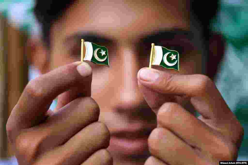 A young Pakistani vendor sells pin badges with his country's national flag ahead of Independence Day, which is marked on August 14.