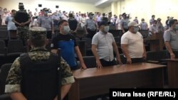 The courtroom listens as the judge delivers the verdicts in Shymkent on July 26.