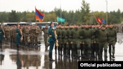 Russia - Armenian soldiers (left) march at the Mulino training center during the opening ceremony of the Russian-Belarusian Zapad-2021 military exercises, September 9, 2021.
