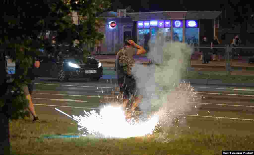 An explosive detonates next to a man in Minsk on August 10.