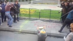 Macedonian Activists Use Paint Slingshot To Target Government Building