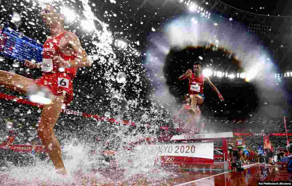 Athletics - Men's 3000m Steeplechase - Final - Olympic Stadium, Tokyo, Japan - August 2, 2021. Soufiane Elbakkali of Morocco and Mohamed Tindouft of Morocco in action.
