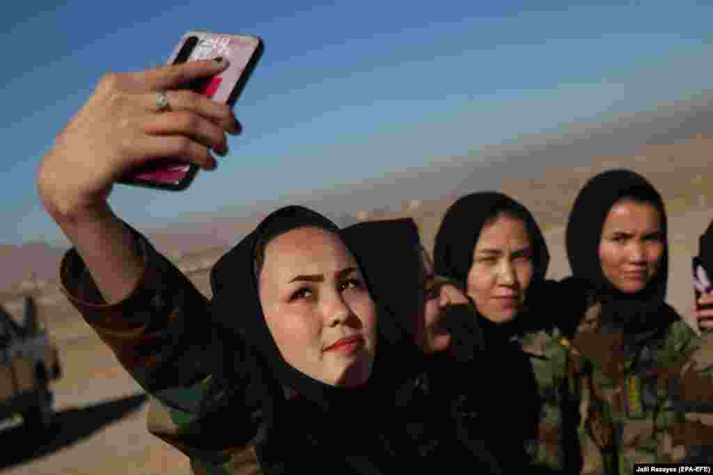 Afghan female soldiers take a selfie as they attend a training session in Herat. Although Afghan forces have maintained an average of 350,000 male officers for years, the number of women in security bodies remains only a few thousand, mainly due to cultural reasons. Most traditional Afghan families reject the idea of a woman working outside their home, particularly in the security forces. (epa-EFE/Jalil Rezayee)