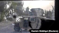 Képek az afgán harcvonalról: fegyveres mentőakció és rakétatámadás