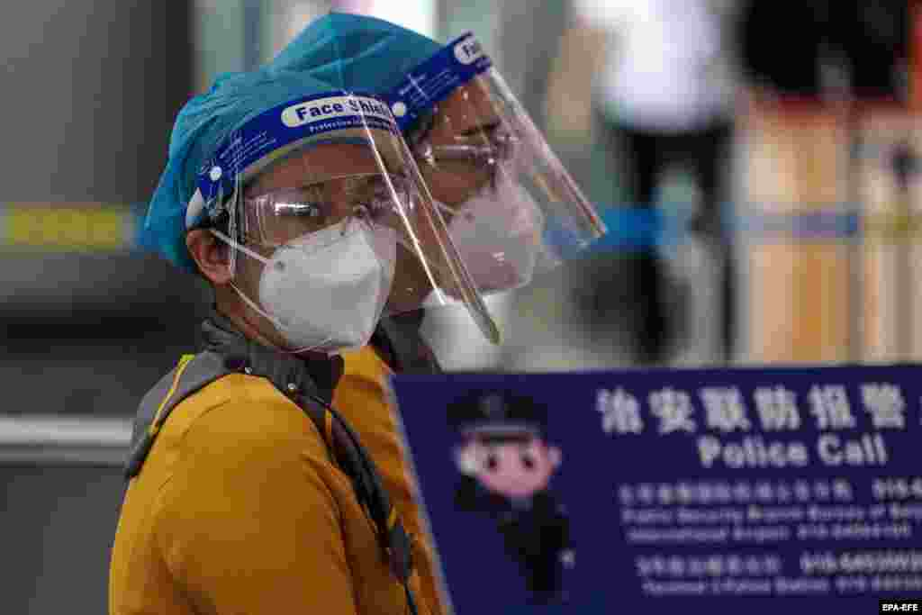 Airport staff wearing protective face masks at terminal 3 of Beijing Capital International Airport in Beijing, China, 17 June 2020. Beijing cancelled over 1,200 flights amid new outbreak woes, as a spike in Coronavirus cases continues.