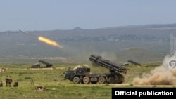 Armenia -- Smerch multiple-launch systems fire rockets during an Armenian military exercise, May 21, 2020.