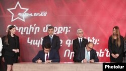 Armenia - Former President Serzh Sarkissian and former National Security Service Director Artur Vanetsian look on as their political parties officially set up an electoral alliance at a ceremony outside Yerevan, May15, 2021.