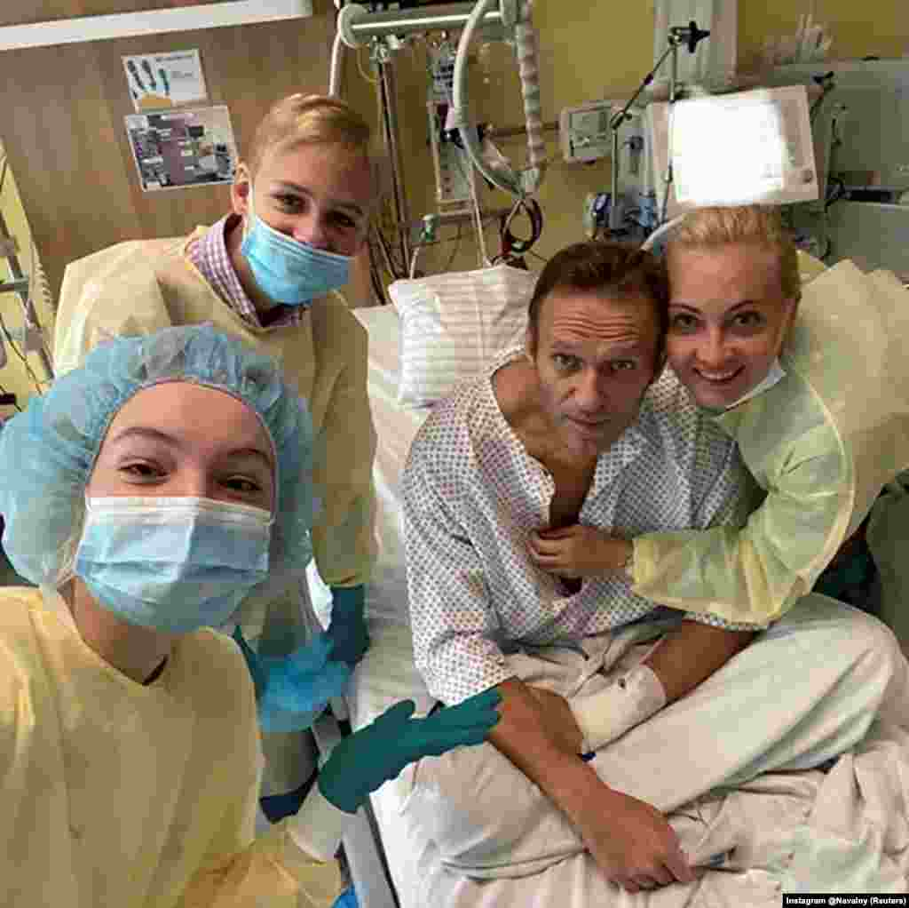Russian opposition politician Aleksei Navalny poses on September 15 with family members at Charite hospital in Berlin, where was is being treated for severe poisoning. (Courtesy of Instagram @NAVALNY via Reuters)