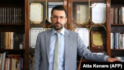 IRAN -- Iranian Babak Paknia, the lawyer of Amirhossein Moradi one of the three people convicted over November protests, speaks during an interview with AFP at his office in the capital Tehran, July 19, 2020