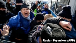 Kazakh police detain a participant in an opposition rally in Almaty on February 28. Human rights groups have said Kazakhstan's law on public gatherings violates international standards.