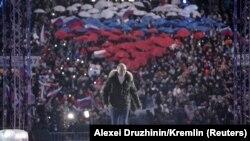 18 martie 2021 - Rusia celebrează șapte ani de la anexarea Crimeei. Vladimir Putin urcă, glorios, pe scenă.