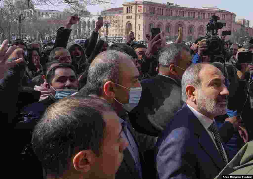 Armenian Prime Minister Nikol Pashinian (right) walks with supporters in central Yerevan. The embattled leader has faced weeks of protests over his handling of the recent conflict with Azerbaijan.
