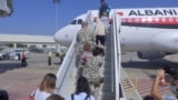 Five Albanians are seen arriving in Albania from Syria