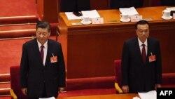 Президентът на Китай Си Цзинпин и премиерът Ли Къцян на откриването на Националния народен конгрес, на който ще се обсъждат промените в избирателната система на Хонконг