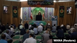 Iranian worshippers attend the Friday Prayers while maintaining social distancing in Tehran Province on June 12.