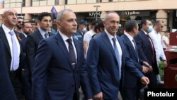 Armenia - Former President Robert Kocharian (C) and other leaders of the newly established Hayastan alliance march through the center of Yerevan, May 9, 2021.