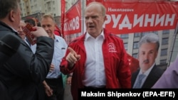 Russian Communist Party leader Gennady Zyuganov (in red) attends campaign event in Moscow on August 26.