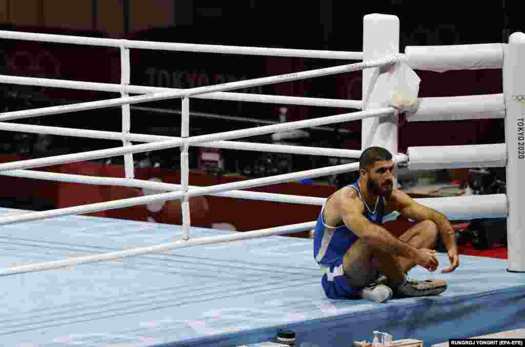 ourad Aliev of France sits outside the ring in protest after losing his match against Frazer Clarke of Great Britain in the Men's Super Heavy (+91kg) quarterfinal match of the Boxing events of the Tokyo 2020 Olympic Games at the Ryogoku Kokugikan Arena in Tokyo, Japan, 01 August 2021. Sitting protest