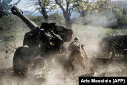 An ethnic Armenian fighter fires heavy artillery during the intense 2020 conflict with Azerbaijan over Nagorno-Karabakh.