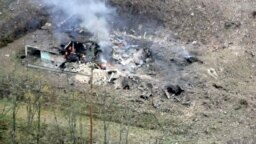 <br /> Кадър от останките от военните складове във Врбетице след взривовете там през 2014 г.